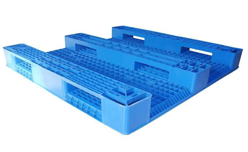 Three skids back plastic pallets