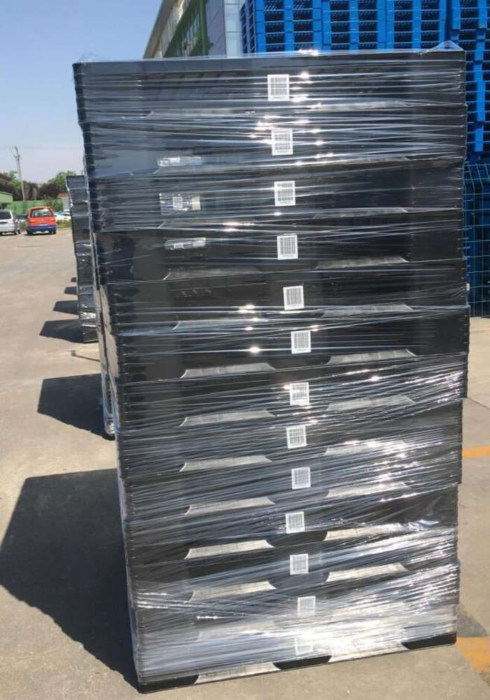 Plastic pallets packed by film
